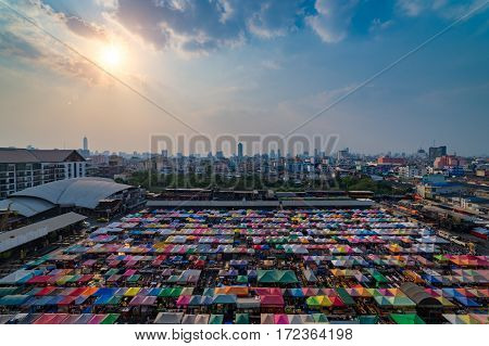 Sunset scence of Bangkok Panorama Aerial view of Bangkok night market in Bangkok city downtown with sunset sky and clouds at Bangkok Thailand. And colourful tents