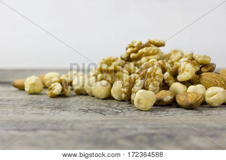 Dry fruits diet on a wooden surface.