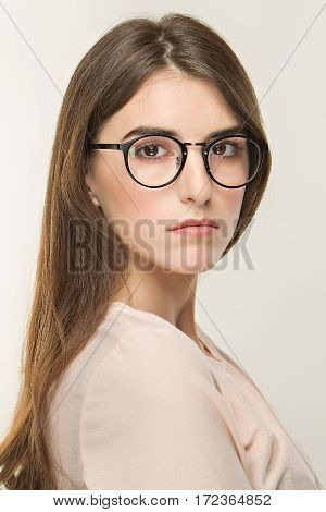 Young Pretty Girl, Classic Portrait On The White Background. Nude Style, Office Look In Glass. Optic