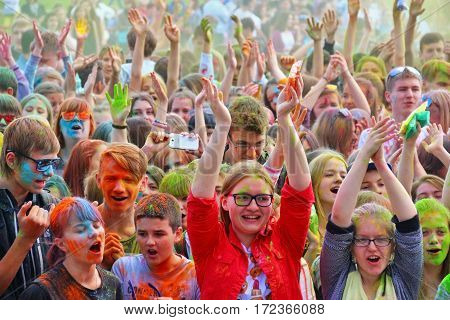 TULA RUSSIA - JUNE 13 2016: Teens at music concert dedicated to festival of colors Holi on June 13 2016 in Tula Russia