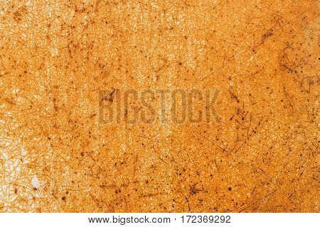 Rusty shabby orange red painted metal texture abstract background. Weathered and cracked surface of iron damaged grunge wall