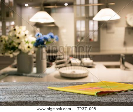 Blurred background. Modern kitchen with tabletop and space for you.
