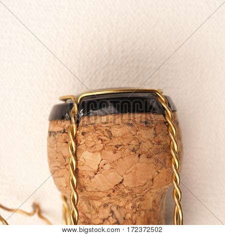 Champagne bottle cork on a white fabric close up shot