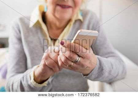 Senior woman holding smartphone and learning new