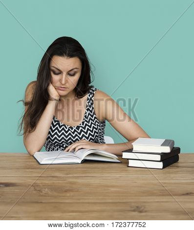 A woman reading a lots of book