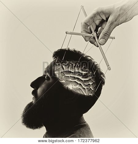 Concept manipulation of consciousness. Image created using multiple exposures on light background. Black and white.