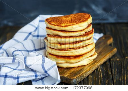 Tasty Pancake And Kitchen Towel.