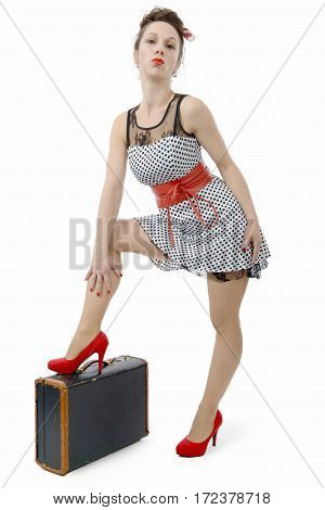 a beautiful woman in retro style with suitcase