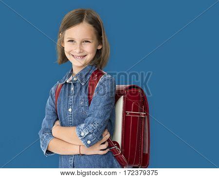 A little school girl is smiling