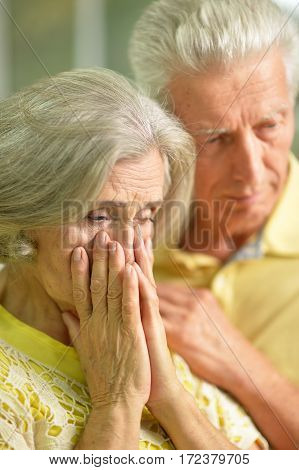 Portrait of a stressed senior couple comforting each other