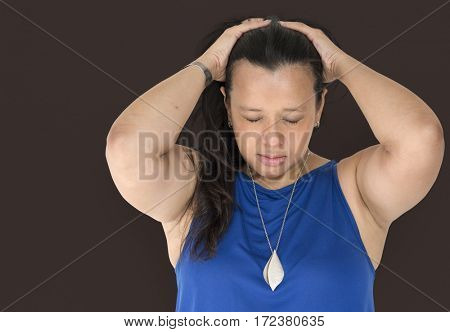 Woman hold and push her hair back
