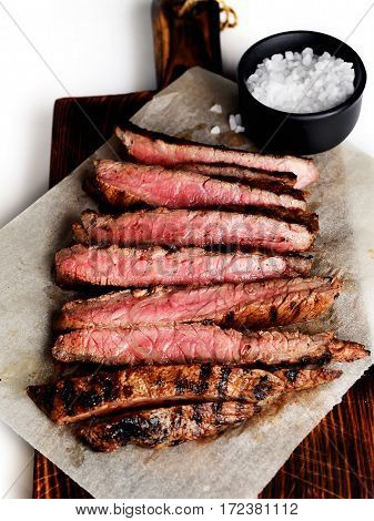 grilled beef on a board on a white background