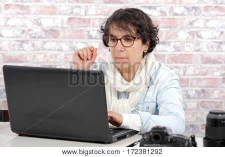 portrait of a middle-aged woman using laptop