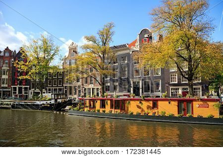 AMSTERDAM/ THE NETHERLANDS - OCTOBER 22, 2014. Houses along the Prinsengracht canal. Amsterdam Netherlands