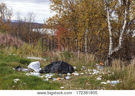 LAPLAND, SWEDEN ON SEPTEMBER 18. Garbage, trash left along a highway by tourists and the transit traffic on September 18, 2016 in Lapland, Sweden. Nu dust-bins in the area. Editorial use.