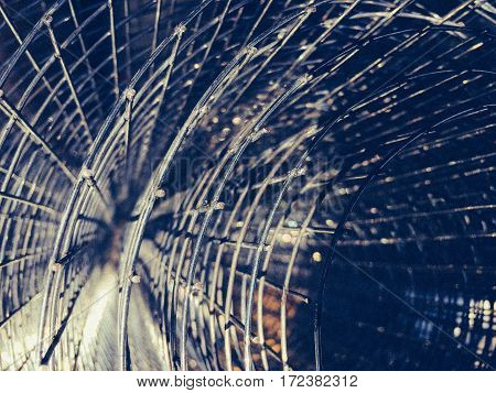 Abstract background of roll wire mesh. Fencing wire closeup retro style.