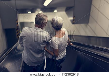 Senior couple traveling around the city