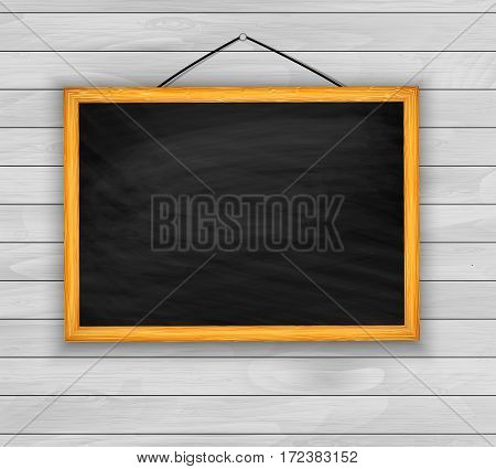 A blackboard on the wooden background vector