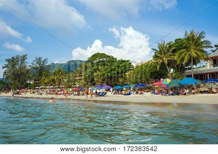 Kata, Phuket, Thailand - February 3, 2017: Tourists on Kata Beach - one of the best beaches in Phuket