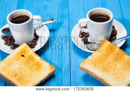 Breakfast, Two Cups Of Coffee And Toast On A Wooden Blue Background