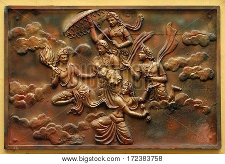 KOLKATA,INDIA - FEBRUARY 09: Janmakalyanaka: Birth celebration of Indra carrying Bhagavan to Mount Meru(Incident-2), bass relief on the wall of Jain Temple (also called Parshwanath Temple) in Kolkata.