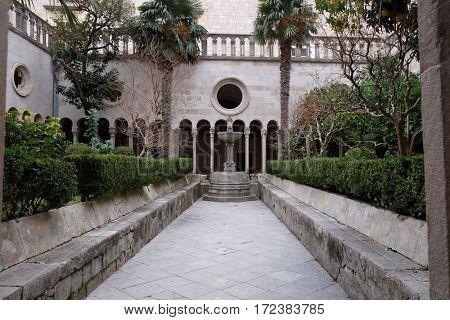 DUBROVNIK, CROATIA - DECEMBER 01: Cloister of the Franciscan monastery of the Friars Minor in Dubrovnik, Croatia on December 01, 2015.