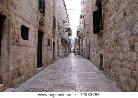DUBROVNIK, CROATIA - DECEMBER 01: Narrow street inside Dubrovnik old town, Croatia on December 01, 2015.