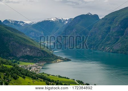 Aurland town and aerial Aurlandsfjorden fjord landscape from old Aurlandsvegen road. Norway.