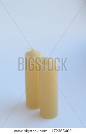Candles on a white background. Soft focus