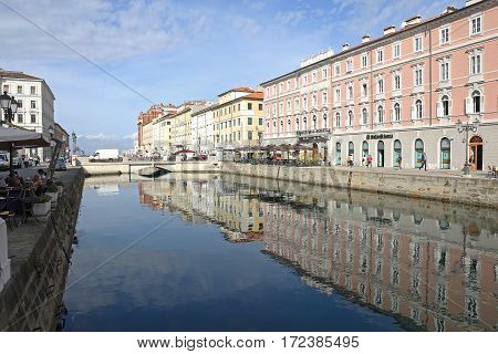 TRIESTE ITALY - OCTOBER 14: Canal Grande in Trieste on OCTOBER 14 2014. Grand Canal Waterway With Palace Buildings in Downtown Trieste Italy.