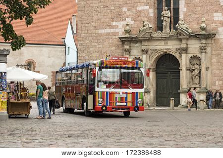 RIGA/ LATVIA - JULY 26, 2015. Tourist bus on the central square at the foot of St. Peter's Church. Old Riga, Latvia