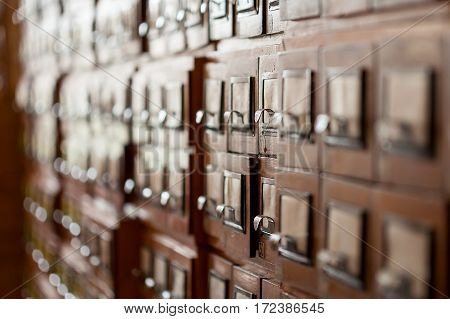 Old wooden cabinets with documents in the library