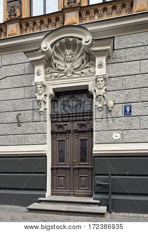 RIGA/ LATVIA - JULY 26. Door of the old apartment building, built in 1905 by Konstantins Peksens in art Nouveau style on Alberta street on July 26, 2015 in Riga Latvia.