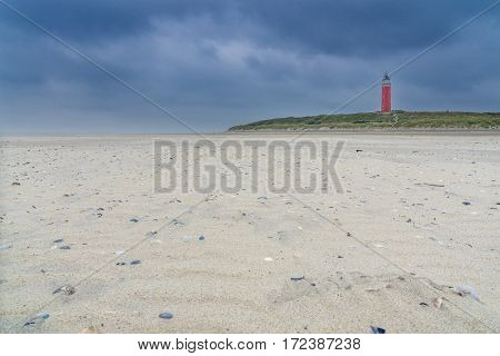 Lighthouse on Texel Island. landscape photo: View of the lighthouse in the north of Texel (Netherlands) on a windy autumn day.