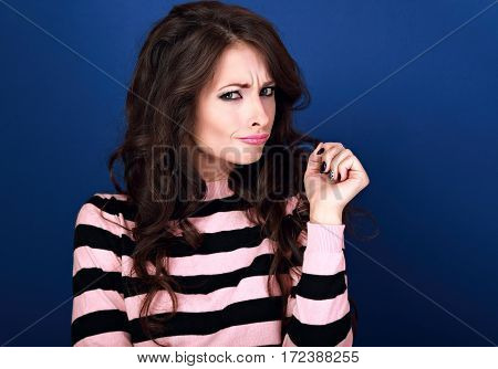 Thinking Funny Confusion Unhappy Beautiful Brunette Makeup Woman Looking On Bright Blue Background