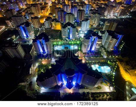 ALANYA, TURKEY - AUG 16, 2015: Area of the complex My Marine Residence at night, aerial photo