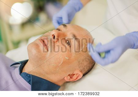 Relaxed Man Having A Face Massage And A Peeling Treatment