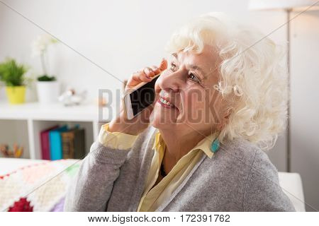 Senior woman talking on the phone and smiling