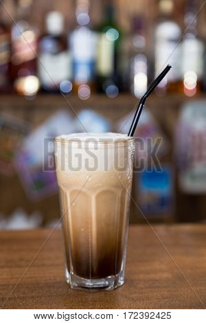 Alcohol Cocktail On Wooden Bar With Bar Background