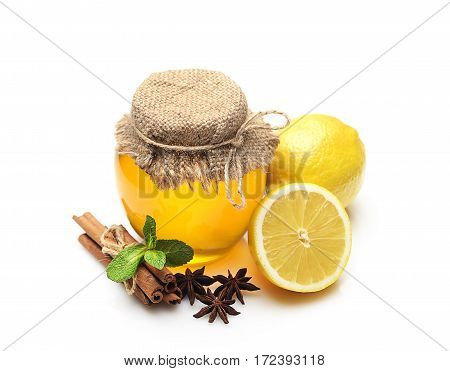 Honey, ginger, lemon and spices on a white background