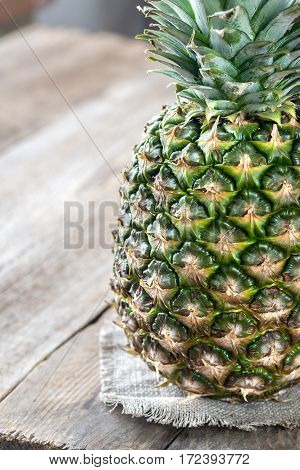 Pineapple On The Wooden Background