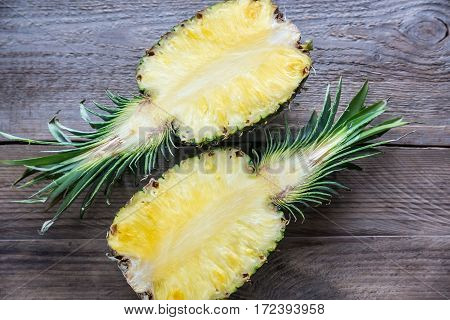 Pineapple On The Wooden Background: Cross Section