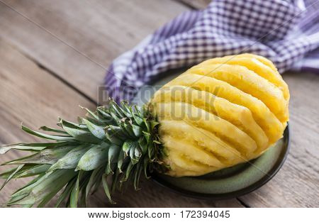 Pineapple On The Plate On The Wooden Background
