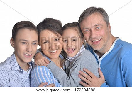 Portrait of a happy smiling family posing together