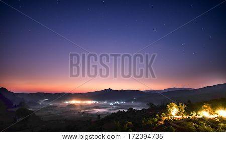 Landscape of Milky way mountain and Bamboo hut at night sky PHU LANG KA Phayao THAILAND