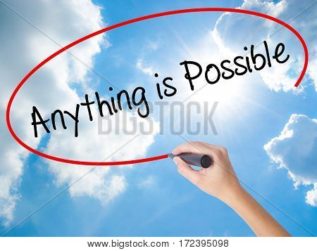 Woman Hand Writing Anything Is Possible With Black Marker On Visual Screen