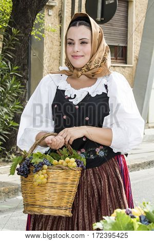 QUARTU S.E., ITALY - September 21, 2014: Parade of Sardinian costumes and floats for the grape festival in honor of the celebration of St. Helena - Sardinia
