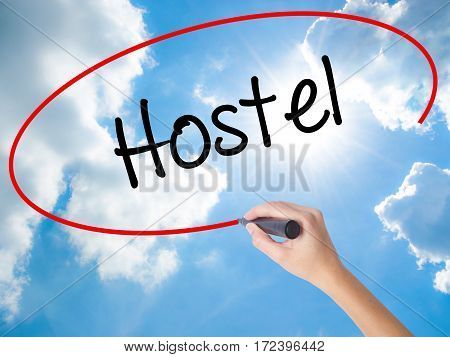 Woman Hand Writing Hostel With Black Marker On Visual Screen