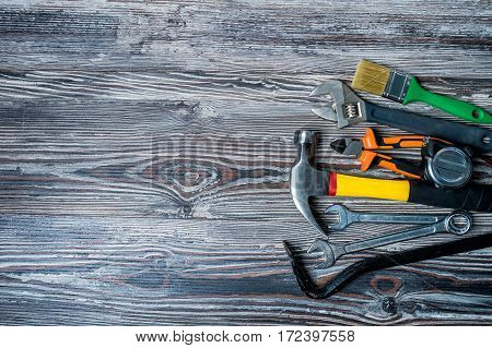 construction tools on a black wooden background