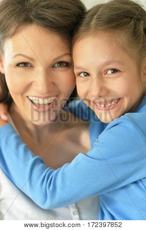 happy mother and daughter close up portrait